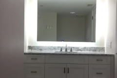 Bathroom with a large mirror.